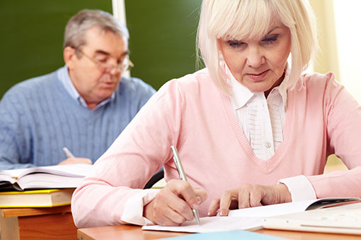 fees-elderly-man-and-woman-doing-a-test